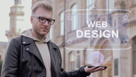 Smart young man with glasses shows a conceptual hologram Web Design Footage
