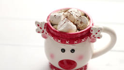 Tasty homemade christmas hot chocolate or cocoa with marshmellows ビデオ