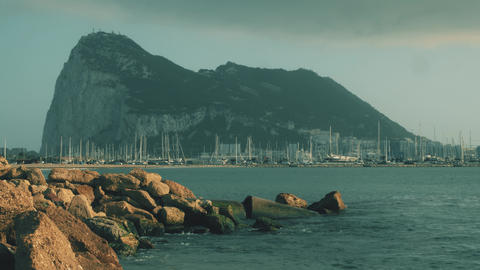 Western side of the Gibraltar Rock and docked sailboats at marina GIF