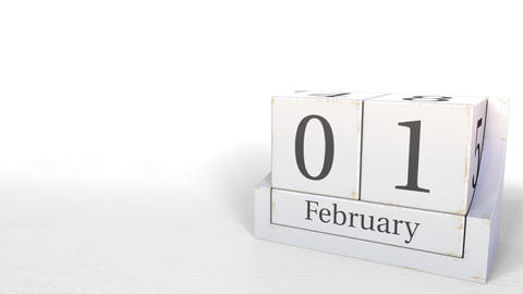Wood cube calendar shows February 1 date, 3D animation Live Action
