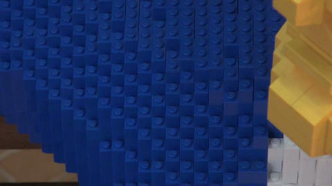 The man in the natural size of the LEGO Stock Video Footage