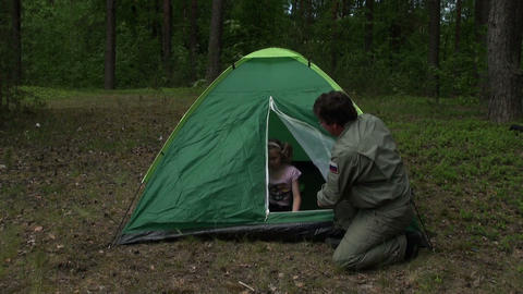 Dad with daughter put a tent Stock Video Footage