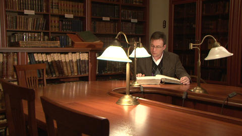 The man flips through an old book Stock Video Footage