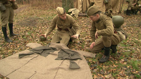 The soldiers at the camp rolled down coat Footage