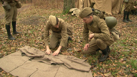The soldiers at the camp rolled down coat Stock Video Footage