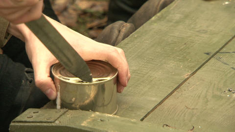 Soldiers with a knife opens canned food Stock Video Footage