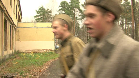 The soldiers marched go through the woods Stock Video Footage
