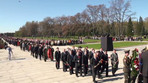 Laying wreaths at the monument Footage