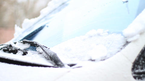 Automobile brushes clean glass from snow Stock Video Footage