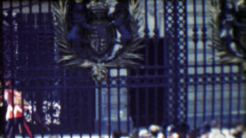 1963: Bearskin Royal British Queen Guards protected behind fenced gates Footage