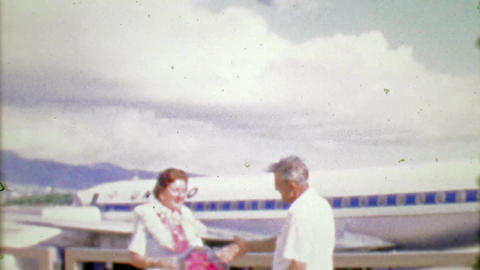 1964: United Airlines pilot greets mature woman passenger outdoors Footage