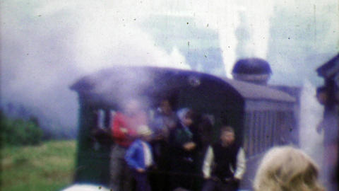 1964: Family riding Cog Railway on cloudy steamy gray day Footage