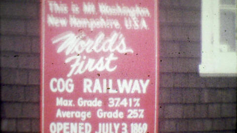 1964: World's 1st Cog Railway sign steam train intersection Footage