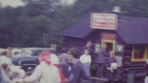 1964: Teenagers playing ring around the rosey game at Cog Railroad station Footage