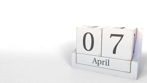 Wood cube calendar shows April 7 date, 3D animation Footage