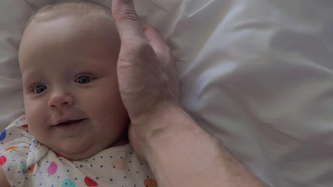 Loving father stroking head of lovely baby daughter Stock Video Footage