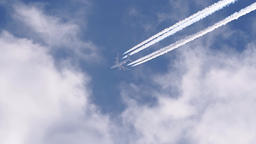 Passenger airplane above with vapor trail Footage