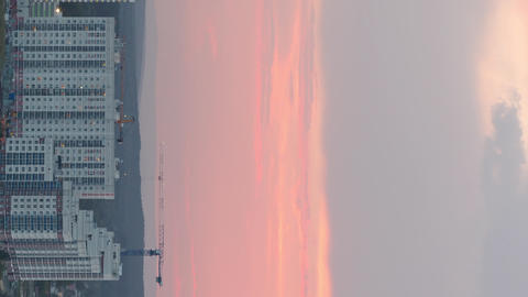 Vertical video. Red sunset. In the windows of the light turns on. Ekaterinburg, ビデオ