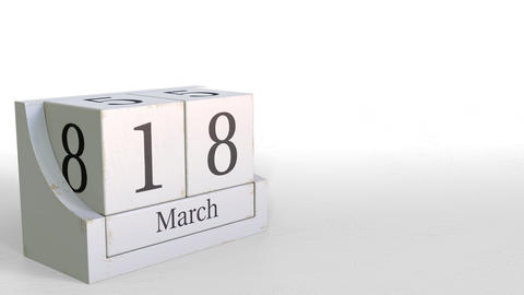 Wooden blocks calendar shows March 18 date, 3D animation Live Action