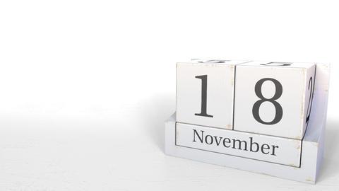 November 18 date on wooden blocks calendar. 3D animation Live Action