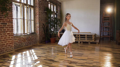 Graceful young ballerina in white dress tutu and pointe shoes performed ballet Live Action