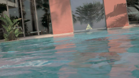Child bathing in outdoor swimming pool. He diving and coming to the surface GIF