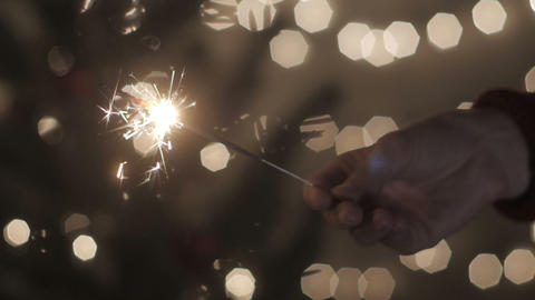 Hand girl with sparkler in celebrate party at home Footage