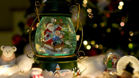 Christmas decoration, snow dome, globe with table decoration ビデオ