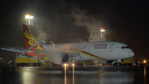 Anti-icing Boeing 787-8 Dreamliner of Hainan Airlines at night Footage