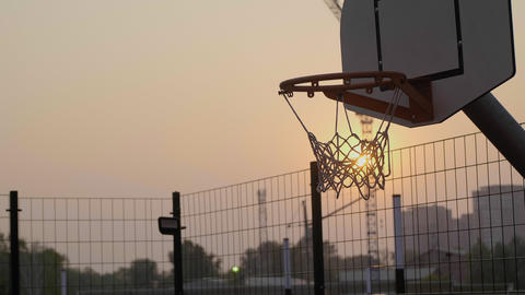 Basketball hoop close up at sunset and scored ball ビデオ