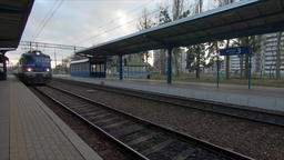 Train pulls into the platform in the early morning. Elblag city, Poland ビデオ