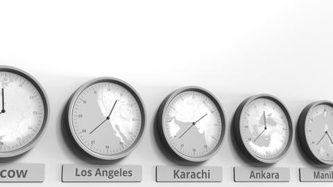 Round clock showing Karachi, Pakistan time within world time zones. Conceptual Footage