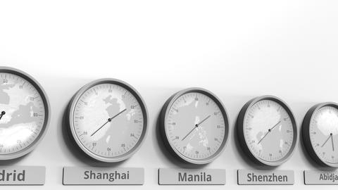 Round clock showing Manila, Philippines time within world time zones. Conceptual Live Action