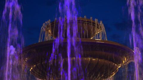 Fountain rising against evening sky ビデオ