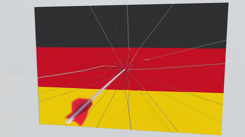 Flag of GERMANY plate being hit by archery arrow. Conceptual 3D animation Live Action
