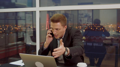 Young businessman is having an unpleasant conversation on the cell phone Live Action