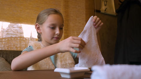 Little girl cleaning her hands with wet towel ビデオ