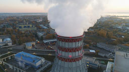 aerial motion around steam cloud rising over cooling tower Footage