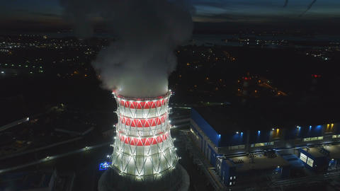 aerial motion to cooling tower with steam at station in dusk Footage