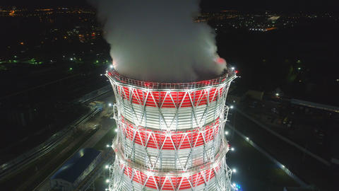 upper view steam pillar over modern cooling tower in dusk Footage