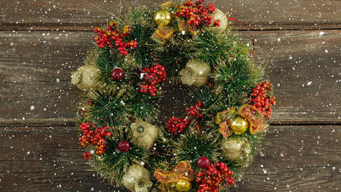 Falling snow with Christmas wreath decoration Animation