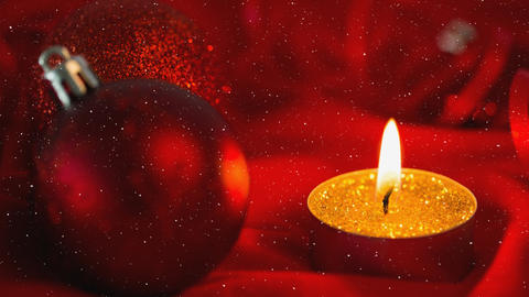 Falling snow and Christmas candle with bauble decorations Animation