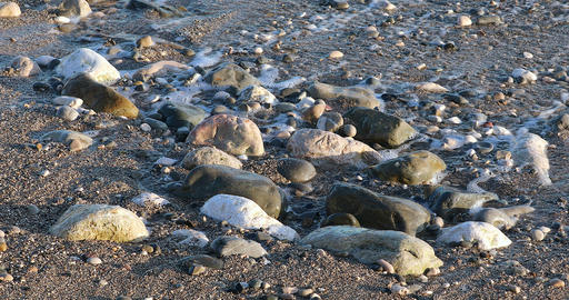 Foamy Sea Waves On Sand Beach And Stones GIF