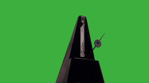 Metronome on a green background Live Action