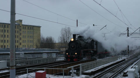 historic steam train in a cloud of smoke Live Action