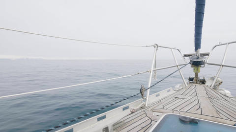 View from bow yacht sailing on sea on cloudy sky background Live Action