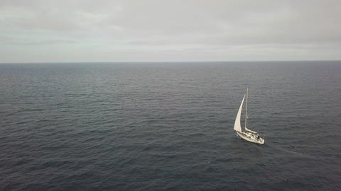 White sail yacht sailing in blue sea and cloudy sky landscape drone view Live Action