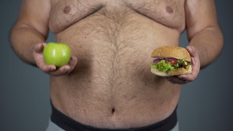Obese male making decision to eat unhealthy, overweight problem, cholesterol Live Action