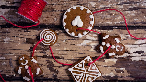 Falling snow with Christmas decoration cookies Animation