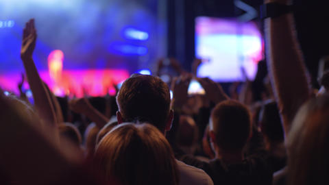Audience at the concert giving applause to favourite music band Footage